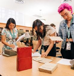 Participants view rare print material in Stanford's Special Collections in the library.