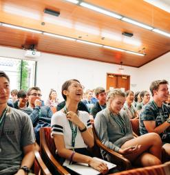 Students laugh during a presentation at the Stanford Humanities Center.