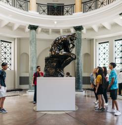 Participants look at Rodin's The Thinker